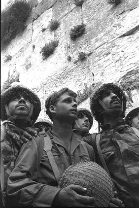 Israeli paratroopers stand in front of the Western Wall in Jerusalem.
